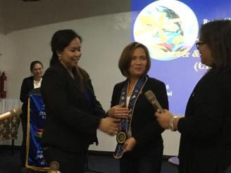 Transfer of Rotarian Lei